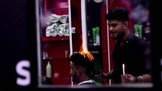 This Barber Cuts Hair With Fire