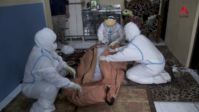 The volunteers burying COVID-19 victims in Indonesia